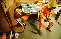 """Exhausted crewmen crash in the galley of the fishing vessel Polar Lady while their boat travels to the next string of pots. Crabbers sleep four to six hours a night, less when the fishing is good. They work seven days a week for several months. There is no such thing as sympathy on a crab boat. With only a crew of five or six men, the sick or injured can't go to bed and recuperate. Crabbers often exist on one hot meal, sandwiches, candy bars, sodas, and a staple of ibuprofen and flu medicines.  The Bering Sea is known for having the worst storms in the world. Crab fishing in the Bering Sea is considered to be one of the most dangerous jobs in the world.  This fishery is managed by the Alaska Department of Fish and Game and is a sustainable fishery.  The Discovery Channel produced a TV series called """"The Deadliest Catch"""" which popularized this fishery."""