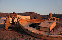An abandoned traditional fishing boat on the Playa de las Salinas beach at Almadraba de Monteleva, built in the 19th century to house salt collectors, now housing only a handful of inhabitants, in the Cabo de Gata-Nijar Natural Park, Almeria, Andalusia, Southern Spain. The park includes the Sierra del Cabo de Gata mountain range, volcanic rock landscapes, islands, coastline and coral reefs and has the only warm desert climate in Europe. The park was listed as a UNESCO Biosphere Reserve in 1997 and a Specially Protected Area of Mediterranean Importance in 2001. Picture by Manuel Cohen