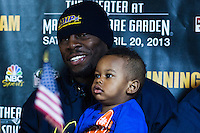 "American boxer Steve ""USS"" Cunningham holds a baby as he attends a press conference to promote his official IBF Heavyweight Voluntary Eliminator fight in New York. April 17, 2013. photo by Eduardo Munoz Alvarez / VIEWpress"