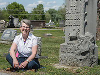 NWA Democrat-Gazette/ANTHONY REYES &bull; @NWATONYR<br /> Abby Burnett, author, Tuesday, April 21, 2015 next to one of the tombstones at Bluff Cemetery that piqued her interest in Springdale.