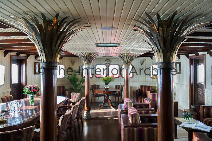 The dining saloon and lounge area features a series of 1930s style columns decorated with brass and copper fronds to resemble palm trees