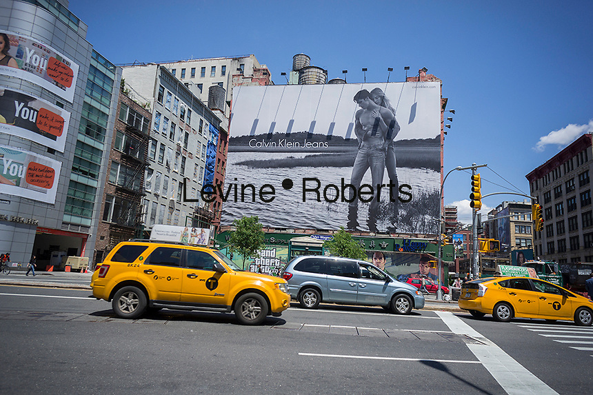 A Calvin Klein billboard in the Soho neighborhood of New York on Tuesday, May 20, 2014. Klein's advertisements use sex and provocative images to test society's cultural and moral boundaries. (© Richard B. Levine)