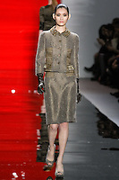 Ming walks runway in a rustic rocky/northwood metallic tweed fitted jacket and metallic tweed pencil skirt with contrast inset, from the Reem Acra Fall 2012 Feminine Power collection fashion show, during Mercedes-Benz Fashion Week New York Fall 2012 at Lincoln Center.