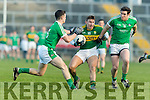 James O'Donoghue Kerry in action against Paul White and Ger Collins Limerick in the Final of the McGrath Cup at the Gaelic Grounds on Sunday.