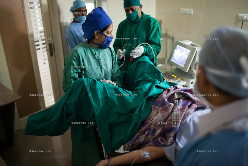 Dr. Nayana Patel, performs an IVF egg retrieval on a patient in her Akanksha Infertility Center in Anand, Gujarat, India on 12th December 2012. She had done her first successful surrogacy birth in 2003, and has delivered over 565 babies since the clinic's establishment. While 15% of couples are infertile globally, only 6% of infertility cases require surrogacy as a last option. Photo by Suzanne Lee / Marie-Claire France