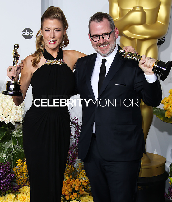 HOLLYWOOD, LOS ANGELES, CA, USA - MARCH 02: Caitrin Rogers, Morgan Neville at the 86th Annual Academy Awards - Press Room held at Dolby Theatre on March 2, 2014 in Hollywood, Los Angeles, California, United States. (Photo by Xavier Collin/Celebrity Monitor)