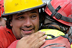 Oscar Oliva, a member of a Mexican search and rescue team, cries with joy on January 19 as he embraces a fellow rescuer after the group pulled 70-year old Ena Zizi from the rubble of Haiti's devastating earthquake, exactly one week after the city was reduced to ruins in a matter of seconds. Zizi was rescued from the collapsed home of the parish priest at Port-au-Prince's Roman Cathedral Cathedral of Our Lady of the Assumption. Oliva is a firefighter from the Mexican city of Quintana Roo.