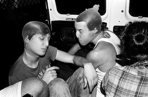 """Summer 2002, New York, NY.. Crew members keep an eye on the duffle bag containing the client as they drive to a werehouse to continue the job.. In the summer of 2002, New York based artist, Brock Enright and a group of his friends from Virginia, started a kidnapping service called Videogames Adventure Services. The clients would hire them to provide a reality based kidnapping experience, while still retaining the ability to stop the """"game"""" at anytime. Parameters were set ahead of the service, detailing the activities to be performed, but the actual time of the kidnapping was kept secret to add to the fantasy. An abuse fetish seemed to be shared by the clients as the activites were more physical than sexual in nature. Prices started at $2500 and the imagination of the client and actors were the only limits."""