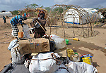 A Somali refugee family that arrived in recent weeks at the Dadaab camp in northeastern Kenya disassembles their house and pack their belongings to move into a new extension of the world's largest refugee settlement. Swelled with tens of thousands of recent arrivals fleeing drought in Somalia, the camp has been unable to absorb the newest arrivals. The Lutheran World Federation, a member of the ACT Alliance, is manager of the camp and in July began moving hundreds of families into tents in the extension.