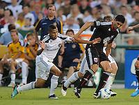 DC United forward Pablo Hernadez (21) shields the ball against LA Galaxy midfielder Sean Franklin (23). LA Galaxy defeated DC United 2-1 at RFK Stadium, Saturday July 18, 2010.