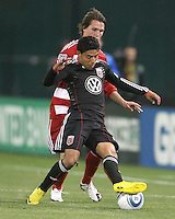 Cristian Castillo #12 of D.C. United turns the ball away from Zach Loyd #19 of F.C. Dallas during a US Open Cup match on April 28 2010, at RFK Stadium in Washington D.C. United won 4-2.