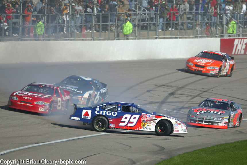 Jeff Burton (99) spins in front of several competitors during  the Pop Secret 400 NASCAR Winston Cup race at Rockingham, NC on Sunday, November 9, 2003. (Photo by Brian Cleary)