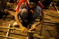 A Red Shirt is preparing new pieces of bamboo for the barricade in front of Silom, near the Lumphini park. Every evening they expected an assault of the army, specially after the first failure of negociations with the government.