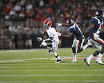 Alabama wide receiver Kenny Bell (7) is tackled by Ole Miss' Nickolas Brassell (2) at Vaught-Hemingway Stadium in Oxford, Miss. on Saturday, October 14, 2011. Alabama won 52-7.