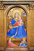 Gothic panel of the (Virgin Mary) Madonna of Humility. Polychrome and gold leaf on wood, circa 1433-1435. The Virgin is seated on a cushion on the floor holding the baby Jesus. She hand a jug with roses a symbol of motherhood and purity. Behind her a gold curtain is held by three angels, while two others are sitting on the floor are playing the organ and lute. The skill of the use of light and shade and the fine brushwork points to an artist of great skill using the Quattrocento style. The piece has been identified as that described by the writer on art Giorgia Vasari in 1568 which was owned Gondi family in Florence.. Inv MNAC 212817. National Museum of Catalan Art (MNAC), Barcelona, Spain