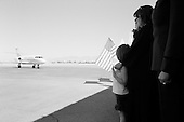 Tucson, Arizona.USA.March 14, 2007..Lori Kasson with her 5 year old granddaughter, and three children Lisa Varnes (22) married), Jeremy (19), Dale (15) and a second grand child 2, wait at a charter flight landing strip for the return of her husband Staff Sgt. Darrel D. Kasson, 43, of Florence, Ariz. He died Mar. 4 in Tikrit, Iraq, of wounds suffered when an improvised explosive device detonated near his vehicle at Bayji, Iraq. He was assigned to the 259th Security Forces Company, Phoenix.