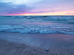 Beautiful sunset scenery of lake Huron in soft pastel colors, Pinery Provincial Park, Grand Bend, Ontario, Canada.