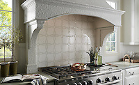 This custom kitchen features a Waverly mosaic backsplash shown in polished Calacatta Tia and honed Thassos from the Silk Road Collection by Sara Baldwin for New Ravenna. <br />