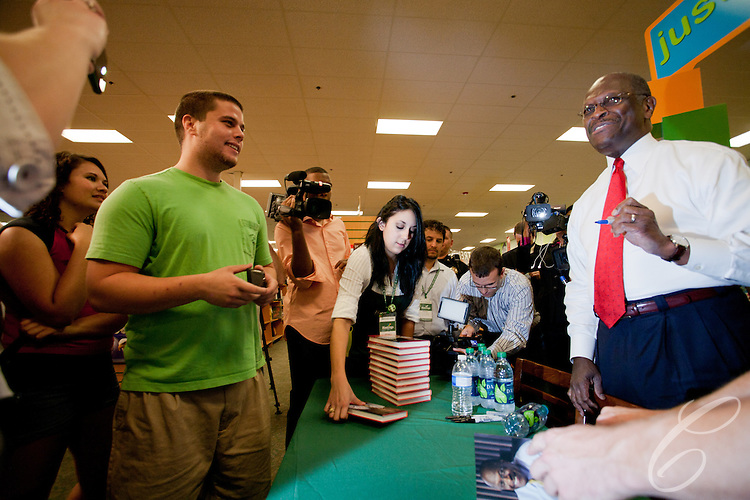 "Presidential candidate Herman Cain stopped in College Station, Texas to sign his book ""This is Herman Cain"" on October 6, 2011. College Station is the home of Texas A&M University and the alma mater Cain's Republican rival Rick Perry."