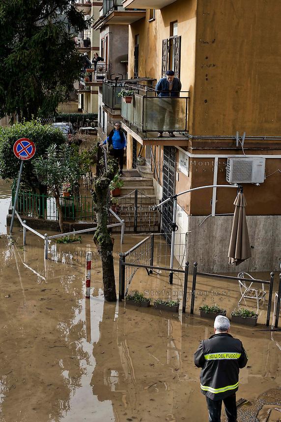 Roma 1 Febbraio 2014<br /> Anziani bloccati in casa per l'acqua sulla strada  al quartiere Prima Porta, a Roma.<br /> Roma &egrave; stata una delle citt&agrave; pi&ugrave; colpite da un'ondata di pioggia torrenziale che ha provocato numerosi allagamenti in vari quartieri della citt&agrave;.<br /> Rome February 1, 2014 <br /> Elderly stranded in the house for the water on the road,  the neighborhood Prima Porta,to  Rome. <br /> Rome has been one of the cities worst hit by a wave of torrential rain, that caused flooding in several different neighborhoods of the city.
