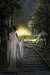 female standing on railway track near a horse
