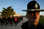 Company Commander Vaughan Sutton, watches Seaman Recruits go through early mourning drill during Boot camp at The United States Coast Guard Training Center Cape May, NJ.