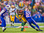 14 December 2014: Green Bay Packers running back Eddie Lacy crosses midfield for a 17-yard gain in the first quarter against the Buffalo Bills at Ralph Wilson Stadium in Orchard Park, NY. The Bills defeated the Packers 21-13, snapping the Packers' 5-game winning streak and keeping the Bills' 2014 playoff hopes alive. Mandatory Credit: Ed Wolfstein Photo *** RAW (NEF) Image File Available ***