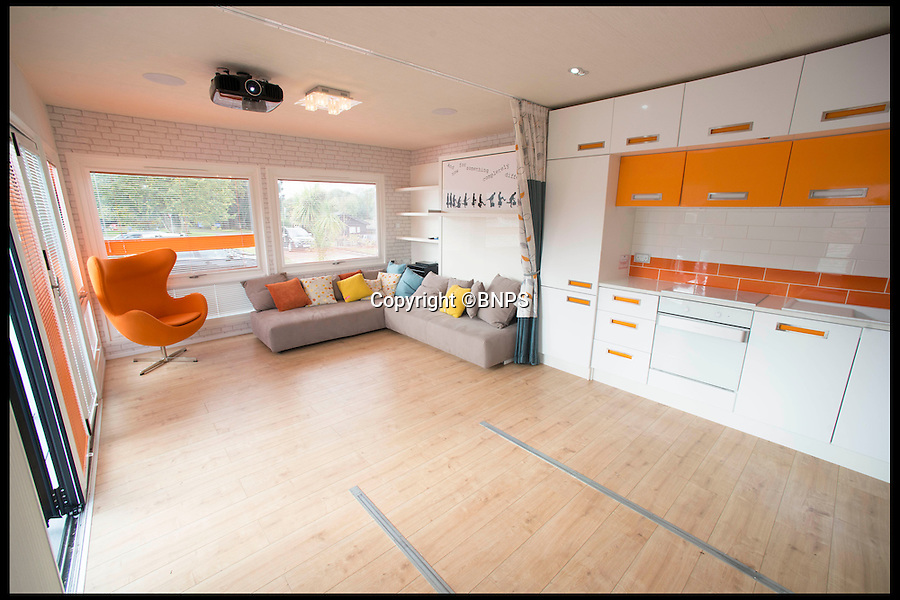 BNPS.co.uk (01202 558833)<br /> Pic: LauraDale/BNPS<br /> <br /> The caravan's communal area, with all features folded and put away.<br /> <br /> A new mobile home that has movable walls to maximise the space the owner is using at the time is set to revolutionise the humble caravan holiday.<br /> <br /> The Concept Caravan measures 30ft by 13ft and uses the same area for different functions at different times.<br /> <br /> During the day, the movable bedroom wall is pushed back, freeing up an extra 60sq ft of room to create and impressive open-plan living space that has room for a 10 seater dining table.<br /> <br /> At night, the wall comes out and with it a foldaway bed to form a comfortable double bedroom.