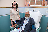 Doctor talking to a patient on the Nottingham City Hospital Renal Unit.  MR