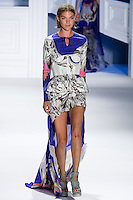 Arizona Muse walks runway in an indigo psychedelic printed stretch cotton long sleeve pullover, White eyelet mesh peplum bustier with indigo printed cotton bust detail, and.indigo psychedelic printed chiffon carved hem skirt by Vera Wang, for the Vera Wang Spring 2012 collection, during Mercedes-Benz Fashion Week Spring 2012.
