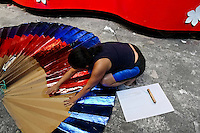 A Colombian woman works on the allegorical float in the Carnival workshop, Barranquilla, Colombia, 23 February 2006. The Carnival of Barranquilla is a unique festivity which takes place every year during February or March on the Caribbean coast of Colombia. The allegorical floats and masks are created by artists with their teams. These crews are highly specialized to design and create large floats because they keep this profession in the family for decades.