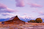 Purple and blue light colors the sky over the Moulton barn in Grand Teton National Park.