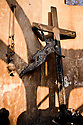 A charred crucifix stands in the charred remains of the cemetery Chapel at Rapti village in the Peloponnese;