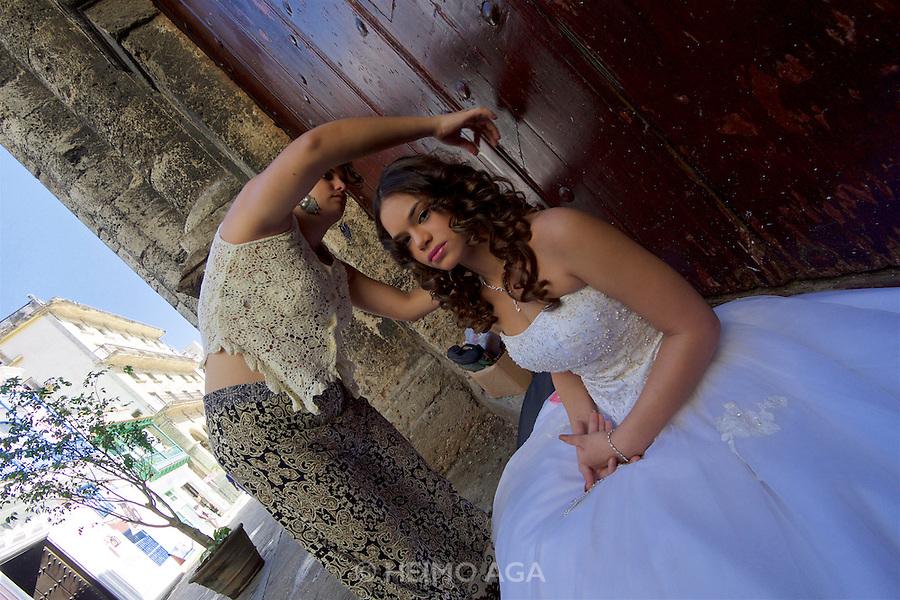 Havana, Cuba. La Habana Vieja (Old Habana). A bride being prepared for a photo shoot.