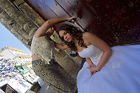 Havana, Cuba. La Habana Vieja (Old Habana). A bride being prepared for a photo shoot.