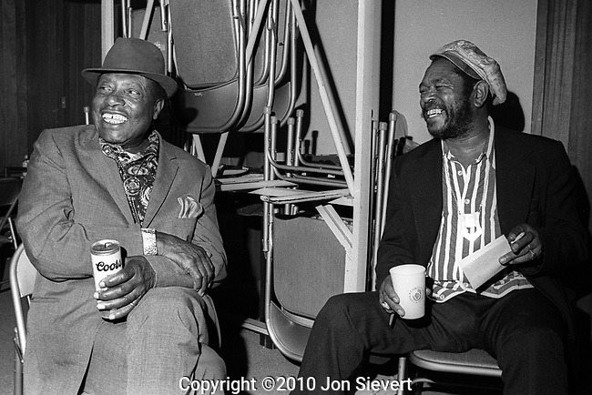 Bukka White and Brownie McGhee, January 17,1975, Berkeley Blues Festival. Two pioneers of the blues. Delta blues guitarist and singer. Born Booker T. Washington (Bukka) White between Aberdeen and Houston, Mississippi, he gave his cousin B.B. King, a Stella guitar, King's first guitar. White himself is remembered as a player of National steel guitars.<br /> <br /> McGhee, a blues singer and guitarist,is best known for his collaborations with the harmonica player Sonny Terry. During the blues revival of the 1960s, Terry and McGhee were very popular on the concert and music festival circuits, occasionally adding new material but usually remaining faithful to their roots and their audience.