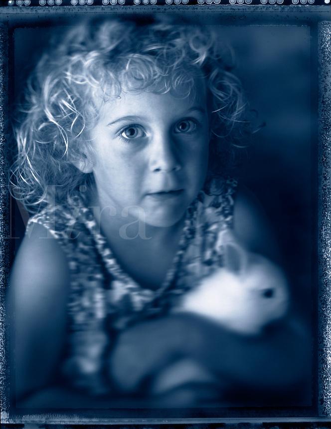 Girl with bunny rabbit.