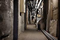 Corridor between the Plant History Glasshouse (formerly Australian Glasshouse), 1830s, Rohault de Fleury, Jardin des Plantes, Museum National d'Histoire Naturelle, Paris, France, and the Tropical Rainforest Glasshouse (formerly Le Jardin d'Hiver or Winter Gardens), 1936, René Berger. Low angle view of the long, narrow subterranean corridor.