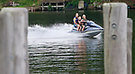 SOUTHBURY CT. 04 July 2015-070415SV02-A jet ski zips by the Lake Zoar boat launch in Southbury Saturday. The lake was busy with holiday boaters. <br /> Steven Valenti Republican-American