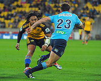 Matt Carraro runs at Ma'a Nonu during the Super Rugby match between the Hurricanes and Waratahs at Westpac Stadium, Wellington, New Zealand on Saturday, 18 April 2015. Photo: Dave Lintott / lintottphoto.co.nz