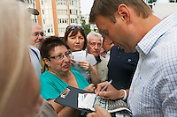 Moscow, Russia, 13/08/2013.<br /> Russian opposition blogger and political activist Alexei Navalny signing autographs and speaking to voters in a residential apartment square as he campaigns as a candidate for Moscow Mayor in elections scheduled for September 8th.