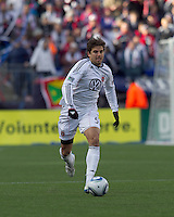 DC United defender Dejan Jakovic (5) brings the ball forward. In a Major League Soccer (MLS) match, the New England Revolution defeated DC United, 2-1, at Gillette Stadium on March 26, 2011.