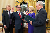 Seven Mnuchin, accompanied by his fiancee Louise Linton, is sworn-in as United States Secretary of the Treasury by Vice President Mike Pence while President Donald Trump watches, during a ceremony at the White House in Washington, D.C. on February 13, 2017. Mnuchin was confirmed by the Senate 54-47. <br /> Credit: Kevin Dietsch / Pool via CNP