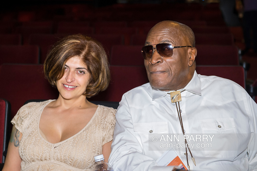 Bellmore, New York, USA. July 16, 2015. R-L, actor JOHN AMOS and ELISABETE DE SOUSA, Co-Founder of Halley's Comet Foundation (HCF), are at the Bellmore Movies theater for the LIIFE Awards Ceremony.  Amos has a fundraising partnership with HCF. At the 18th Long Island International Film Expo, Amos was an LIFTF Lifetime Creative Achievement Honoree for his work in films such as ROOTS, and DIE HARD 2, and COMING TO AMERICA.