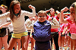 Caleb, 7, dances with participants during the line dance at DanceBlue on March 3, 2012 in Memorial Coliseum. He is celebrating 5 years of being in remission this weekend.