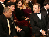 Actor Kevin Spacey (L) and actor Laurence Fishburne (L) wait for the beginning of an event for the 2016 Kennedy Center Honorees, in the East Room of the White House, December 4, 2016. The 2016 honorees are: Argentine pianist Martha Argerich; rock band the Eagles; screen and stage actor Al Pacino; gospel and blues singer Mavis Staples; and musician James Taylor.<br /> Credit: Aude Guerrucci / Pool via CNP