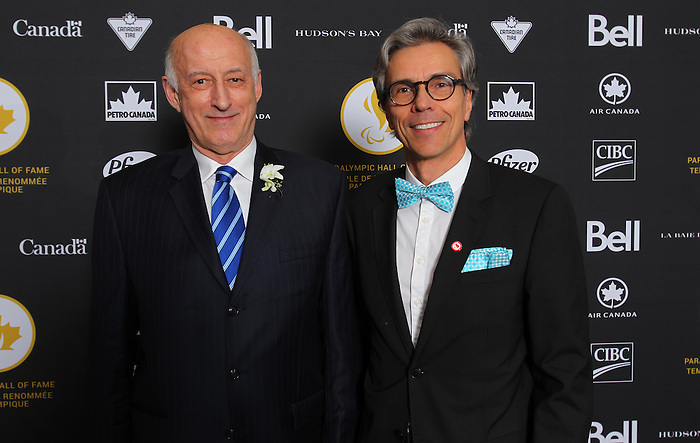 Ottawa, ON – Nov 27 2015 –Donald Royer and CPC President  GaetanTardif pose for a photo at the Canadian Paralympic Hall of Fame in Ottawa, Ontario Nov 27, 2015. Royer was inducted into the Hall of Fame in the builder category. Photo Andre Forget / Canadian Paralympic Committee