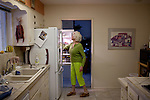"Bonnie Hines grabs something out of the refrigerator while preparing dinner for neighbors in her Sun City home December 8, 2010..""It's gentle, it's quiet,"" she said of Sun City. She exercises at the gym every other day, as well as golfing and is active in the stained glass club...2010 marks the 50th anniversary of Sun City, America's first retirement city that remains the largest today with more than 40,000 residents 55 and older."