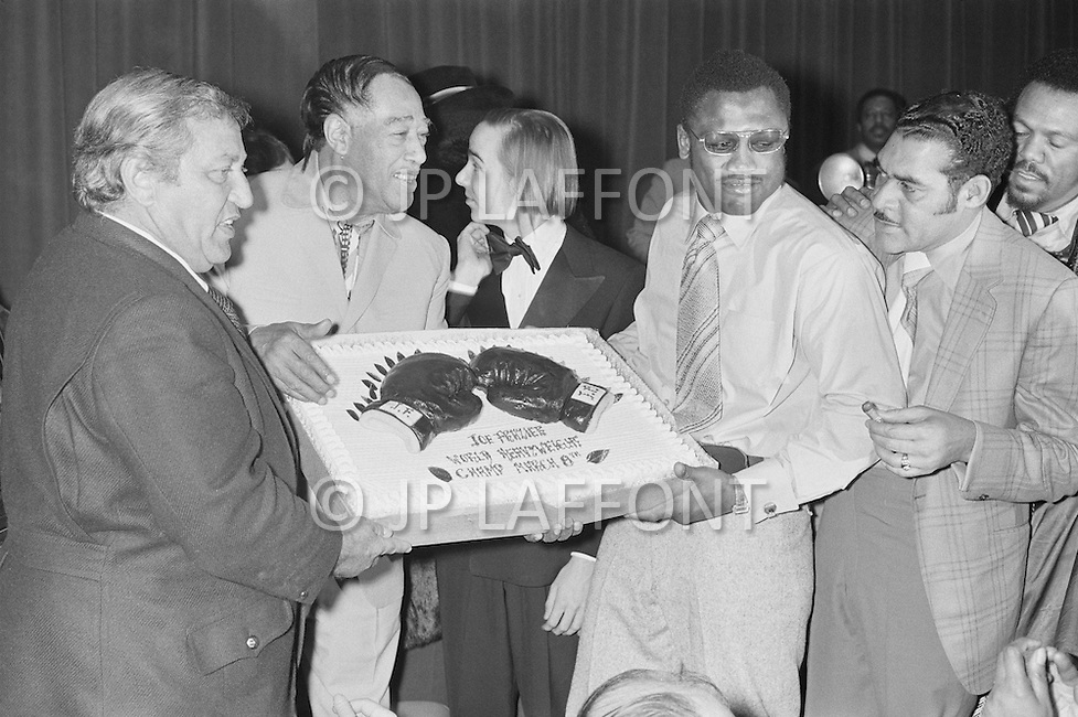 March 8 1971, Manhattan, New York City, New York State, USA --- Boxer Joe Frazier and Musician Duke Ellington hold the victory cake after Joe Frazier defeated Muhammad Ali for the World Heavyweight Championship at Madison Square Garden. --- Image by © JP Laffont/Sygma/CORBIS