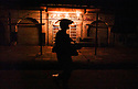 U.S. Army 4th Infantry Division 1-12 soldiers on the streets of Samarra, Iraq during a nightime patrol through the city center August 20, 2003.